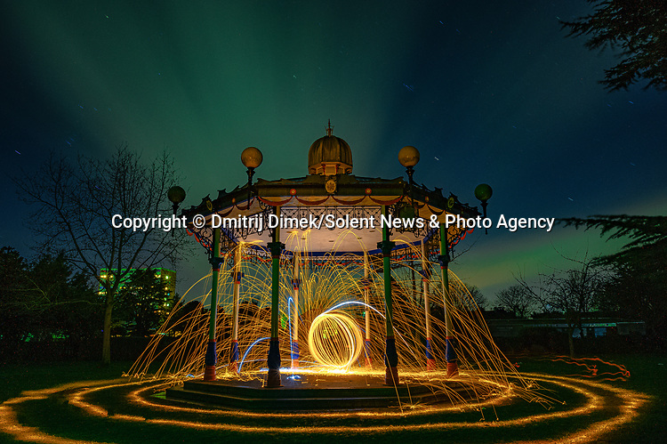 """Pictured:  Priory Park, Southend on Sea<br /> <br /> Amazing photos show sparks illuminating British landmarks as they fly from what appears to be a disc of colourful light.  This unique effect is the result of long-exposure night-time shots of a whisk stuffed with steel wool, which is set alight and spun at the end of a metal chain.<br /> <br /> Amateur photographer Dmitrij Dimek is passionate about what he calls 'light paintings', and took these photos at castles, beaches and other settings around Essex and London.  The 38 year old, who grew up in Poland but now lives in Southend-on-Sea, Essex, said: """"When I first found out about light painting with steel wool, I thought it was an outstanding way to connect with photography.  SEE OUR COPY FOR DETAILS.<br /> <br /> Please byline: Dmitrij Dimek/Solent News<br /> <br /> © Dmitrij Dimek/Solent News & Photo Agency<br /> UK +44 (0) 2380 458800"""