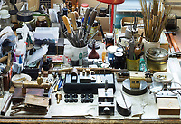 Detail of a table full of tools and equipment in the workshop of the Dale Guild Foundry.