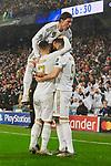 Eden Hazard (L), Karim Benzema (R) and Sergio Ramos of Real Madrid celebrate goal during UEFA Champions League match between Real Madrid and Paris Saint-Germain FC at Santiago Bernabeu Stadium in Madrid, Spain. November 26, 2019. (ALTERPHOTOS/A. Perez Meca)