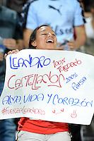 MEDELLIN - COLOMBIA -17-08-2014: Una hincha del Deportivo Independiente Medellin, anima a su equipo durante partido Deportivo Independiente Medellin  y Atletico Huila de la fecha  5 de la Liga Postobon II 2014, jugado en el estadio Atanasio Girardot de la ciudad de Medellin. / A fan of Deportivo Independiente Medellin cheers for their team during a match Deportivo Independiente Medellin and Atletico Huila for the date 5 th of the Liga Postobon II 2014 at the Atanasio Girardot stadium in Medellin city. Photo: VizzorImage  / Luis Rios / Str.