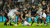 8th October 2021;  Swansea.com Stadium, Swansea, Wales; United Rugby Championship, Ospreys versus Sharks; Gareth Thomas of Ospreys is tackled by Hyron Andrews of Cell C Sharks