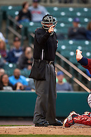 Umpire Chad Whitson makes a call during a game between the Lehigh Valley IronPigs and Rochester Red Wings on May 15, 2015 at Frontier Field in Rochester, New York.  Rochester defeated Lehigh Valley 5-4.  (Mike Janes/Four Seam Images)