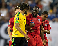 NASHVILLE, TN - JULY 3: Jozy Altidore #17 and Michael Hector #3 discuss a play during a game between Jamaica and USMNT at Nissan Stadium on July 3, 2019 in Nashville, Tennessee.