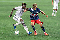 FOXBOROUGH, UNITED STATES - AUGUST 20: Justin Rennicks #12 of New England Revolution tackles Olivier Mbaizo #15 of Philadelphia Union near the New England goal during a game between Philadelphia Union and New England Revolution at Gilette on August 20, 2020 in Foxborough, Massachusetts.