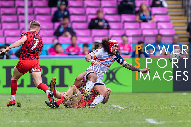 Folau Niua of USA is tackled by the Wales defence during the HSBC Hong Kong Sevens 2018 match between USA and Wales on April 7, 2018 in Hong Kong, Hong Kong. Photo by Marcio Rodrigo Machado / Power Sport Images