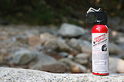 Counter Assault Bear Spray on rock in the White Mountains, New Hampshire USA