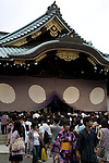 July 13, 2014, Tokyo, Japan - Visitors come to pay respects to their lost relatives and friends during the annual Mitama festival at Yasukuni Shrine on July 13, 2014. The festival celebrates the spirits of lost ancestors and is held across Japan in early July. There are over 30,000 lanterns lining the path to the shrine to help spirits find their way during the festival. Yasukuni Shrine is also the place where more than 2.4 million war dead are enshrined.This year the festival is held from July 13 to 16. (Photo by Rodrigo Reyes Marin/AFLO)