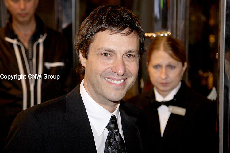 Director Paolo Barzman on the red carpet at Roy Thompson Hall for the world premiere of his film Emotional Arithmetic, at the Toronto International Film Festival on September 15, 2007. (CNW Group/VISA Canada)