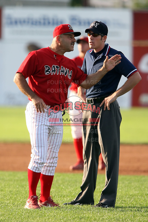 August 7 2008:  Base umpire Mathieu Moisans listens to Batavia Muckdogs manager Mark DeJohn during an argument over a disputed call at first base during a game at Dwyer Stadium in Batavia, NY.  Photo by:  Mike Janes/Four Seam Images