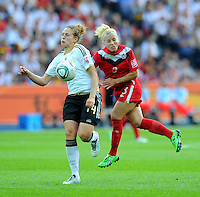 Kim Kulig (l) of Germany and Kelly Parker of Canada during the FIFA Women's World Cup at the FIFA Stadium in Berlin, Germany on June 26th, 2011.