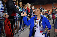 HOUSTON, TX - JANUARY 31: Ali Krieger #11 and fans of the United States celebrate with selfies during a game between Panama and USWNT at BBVA Stadium on January 31, 2020 in Houston, Texas.