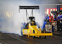 Oct. 31, 2008; Las Vegas, NV, USA: NHRA top fuel dragster driver David Grubnic does a burnout during qualifying for the Las Vegas Nationals at The Strip in Las Vegas. Mandatory Credit: Mark J. Rebilas-