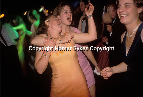 Girl students friendship singing at Cirencester Royal Agricultural College annual end of year dance Gloucestershire England 1997