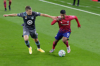 ST PAUL, MN - SEPTEMBER 9: Chase Gasper #77 of Minnesota United FC and Santiago Mosquera #11 of FC Dallas battle for the ball during a game between FC Dallas and Minnesota United FC at Allianz Field on September 9, 2020 in St Paul, Minnesota.