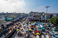 India, New Delhi, busy street view.