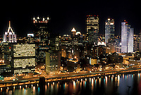 AJ4290, Pittsburgh, aerial, skyline, Pennsylvania, Downtown skyline of Pittsburgh illuminated at night in the state of Pennsylvania. City lights reflect in the calm waters of the Monongahela River.
