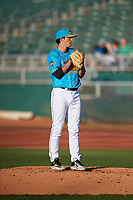 Lansing Lugnuts starting pitcher Troy Miller (14) during a Midwest League game against the Beloit Snappers at Cooley Law School Stadium on May 4, 2019 in Lansing, Michigan. The Lugnuts wore their Copa de la Diversión jerseys, becoming the Lansing Locos for the evening. Beloit defeated Lansing 2-1. (Zachary Lucy/Four Seam Images)