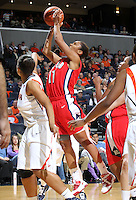 Dec. 6, 2010; Charlottesville, VA, USA; Radford Highlanders guard Denay Wood (11) shoots in front of Virginia Cavaliers guard Ataira Franklin (23) at the John Paul Jones Arena.  Mandatory Credit: Andrew Shurtleff