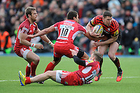 20130303 Copyright onEdition 2013©.Free for editorial use image, please credit: onEdition..Joel Tomkins of Saracens finds a way past Gavin Henson (centre) and Phil MacKenzie of London Welshduring the Premiership Rugby match between Saracens and London Welsh at Allianz Park on Sunday 3rd March 2013 (Photo by Rob Munro)..For press contacts contact: Sam Feasey at brandRapport on M: +44 (0)7717 757114 E: SFeasey@brand-rapport.com..If you require a higher resolution image or you have any other onEdition photographic enquiries, please contact onEdition on 0845 900 2 900 or email info@onEdition.com.This image is copyright onEdition 2013©..This image has been supplied by onEdition and must be credited onEdition. The author is asserting his full Moral rights in relation to the publication of this image. Rights for onward transmission of any image or file is not granted or implied. Changing or deleting Copyright information is illegal as specified in the Copyright, Design and Patents Act 1988. If you are in any way unsure of your right to publish this image please contact onEdition on 0845 900 2 900 or email info@onEdition.com