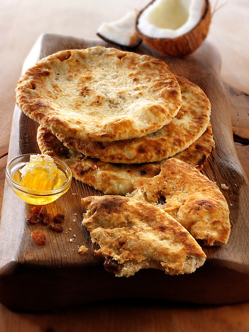 Peshwari Naan. coconut sultanas and honey Bread - Indian Cuisine food stock pictures, photos fotos & images