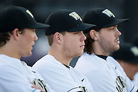 Gavin Sheets (center) watches the Georgetown Hoyas take infield practice at David F. Couch Ballpark on February 19, 2016 in Winston-Salem, North Carolina.  The Demon Deacons defeated the Hoyas 3-1.  (Brian Westerholt/Four Seam Images)
