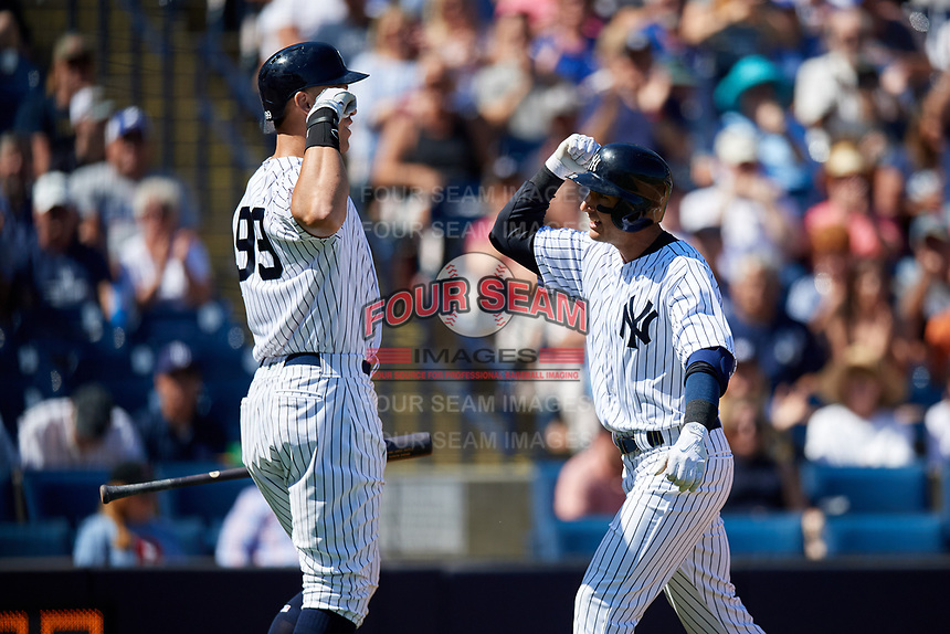 New York Yankees shortstop Troy Tulowitzki (12) celebrates with Aaron Judge (99) after hitting a home run during a Grapefruit League Spring Training game against the Toronto Blue Jays on February 25, 2019 at George M. Steinbrenner Field in Tampa, Florida.  Yankees defeated the Blue Jays 3-0.  (Mike Janes/Four Seam Images)