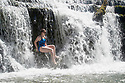 01/07/18<br /> <br /> Chloé Kirkpatrick, 25, cools-off under a waterfall at Monsal Weir near Bakewell in the Derbyshire Peak District.<br /> <br /> All Rights Reserved F Stop Press Ltd. +44 (0)1335 344240 +44 (0)7765 242650  www.fstoppress.com