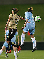 Sky Blue defender, Keeley Dowling (17), heads the ball away from FC Gold Pride striker, Christine Sinclair (12).  Sky Blue FC and FC Gold Pride battled to a 1-1 draw in Bridgewater, NJ on Saturday, April 11, 2009.