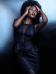 High fashion photo of a beautiful african american woman in stylish black shiny clothes Image © MaximImages, License at https://www.maximimages.com