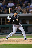 Carlos Sanchez (5) of the Chicago White Sox at bat against the Charlotte Knights at BB&T Ballpark on April 3, 2015 in Charlotte, North Carolina.  The Knights defeated the White Sox 10-2.  (Brian Westerholt/Four Seam Images)