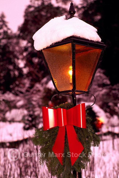 Butchart Gardens, Brentwood Bay near Victoria, Vancouver Island, BC, British Columbia, Canada - Red Christmas Bow on Snow Covered Street Lamp