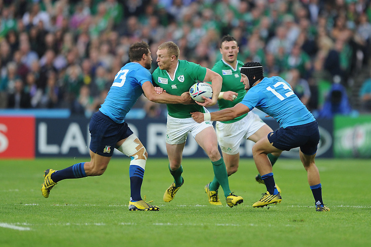 Keith Earls of Ireland is tackled by Michele Campagnaro and Tommaso Benvenuti of Italy during Match 28 of the Rugby World Cup 2015 between Ireland and Italy - 04/10/2015 - Queen Elizabeth Olympic Park, London<br /> Mandatory Credit: Rob Munro/Stewart Communications