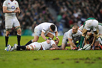 Courtney Lawes of England lies injured after tackling Rob Kearney of Ireland during the RBS 6 Nations match between Ireland and England at the Aviva Stadium, Dublin on Sunday 10 February 2013 (Photo by Rob Munro)
