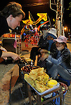 "Asia, Vietnam, Nha Trang. Nha Van Hoa. Tourist purchasing wafer from a street food stall in front of ""Nha Van Hoa"", Nha Trang's Vietnamese Cultural House located at the beach promenade Tran Phu."