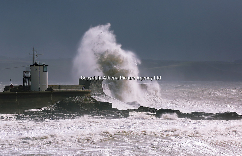 """WEATHER PICTURE WALES<br />Pictured: Waves crashing against the harbour wall and lighthouse in Porthcawl, Wales, UK. Monday 11 September 2017<br />Re: A yellow """"be aware"""" weather warning of very strong winds has been issued across south and west Wales The Met Office HAS warned.<br />Gusts could reach 50 mph inland and 60 mph along the coast."""