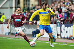 Hearts v St Johnstone....06.05.12   SPL.Cillian Sheridan is closed down by Ian Black.Picture by Graeme Hart..Copyright Perthshire Picture Agency.Tel: 01738 623350  Mobile: 07990 594431