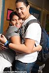 Education High School boy and girl hugging in corridor at school