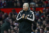 Swansea City caretaker manager Alan Curtis applauds during the Barclays Premier League match between Manchester United and Swansea City played at Old Trafford, Manchester on January 2nd 2016