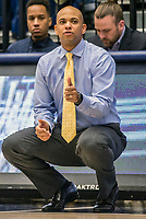WASHINGTON, DC - JANUARY 29: Jamion Christian head coach of George Washington watches a play during a game between Davidson and George Wshington at Charles E Smith Center on January 29, 2020 in Washington, DC.