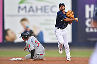 Asheville Tourists shortstop Coco Montes (5) throws over Abrahan Gutierrez (31) to complete  a double play during a game against the Lakewood BlueClaws at McCormick Field on August 3, 2019 in Asheville, North Carolina. The BlueClaws defeated the Tourists 10-6. (Tony Farlow/Four Seam Images)