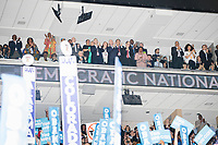Former president Bill Clinton applauds while standing in a box suite while President Barack Obama speaks at the Democratic National Convention at the Wells Fargo Center in Philadelphia, Pennsylvania, on Wed., July 27, 2016.