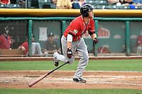 Taylor Lindsey (10) of the El Paso Chihuahuas at bat against the Salt Lake Bees in Pacific Coast League action at Smith's Ballpark on August 7, 2014 in Salt Lake City, Utah.  (Stephen Smith/Four Seam Images)