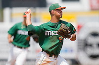 Third baseman Harold Martinez #9 of the Miami Hurricanes makes a throw to first base against the Virginia Cavaliers at the 2010 ACC Baseball Tournament at NewBridge Bank Park May 29, 2010, in Greensboro, North Carolina.  The Cavaliers defeated the Hurricanes 12-8.  Photo by Brian Westerholt / Four Seam Images