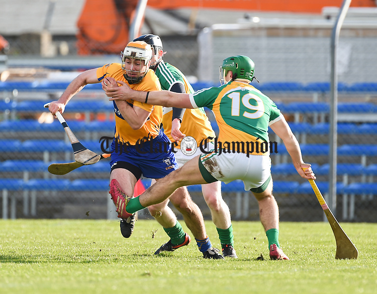 Conor Mc Grath of Clare in action against Joey O Connor of Offaly during their Allianz Hurling League Div1b Round 1 game in Cusack park. Photograph by John Kelly.