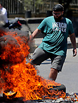 Lebanese protesters burn tires to block a main highway, during a protest against the increase in prices of consumer goods and the crash of the local currency, in Beirut, Lebanon, on June 17, 2021. Shops, government offices, businesses and banks shut their doors Thursday in response to a call for a general strike by Lebanon's main labor union. Photo by Haitham Moussawi