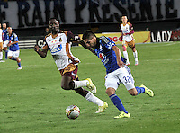 BOGOTA - COLOMBIA -07 -10-2015: Jonathan Agudelo (Der) jugador de Millonarios disputa el balón con Avimiled Rivas (Izq.) jugador de Deportes Tolima, durante partido aplazado entre Millonarios y Deportes Tolima, por la fecha 6 de la Liga Aguila II-2015, jugado en el estadio Nemesio Camacho El Campin de la ciudad de Bogota. / Jonathan Agudelo (R) player of Millonarios vies for the ball with Avimiled Rivas (L) player of Deportes Tolima, during a posponed match between Millonarios and Deportes Tolima, for the date 6 of the Liga Aguila II-2015 at the Nemesio Camacho El Campin Stadium in Bogota city. Photo: VizzorImage / Luis Ramirez / Staff.
