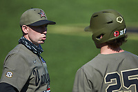 Vanderbilt Commodores assistant coach Mike Baxter chats with Parker Noland (25) during the game against the South Carolina Gamecocks at Hawkins Field on March 21, 2021 in Nashville, Tennessee. (Brian Westerholt/Four Seam Images)