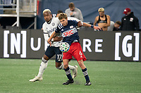 FOXBOROUGH, MA - OCTOBER 19: Sergio Santos #17 of Philadelphia Union and Scott Caldwell #6 of New England Revolution battle for the ball during a game between Philadelphia Union and New England Revolution at Gillette on October 19, 2020 in Foxborough, Massachusetts.