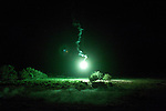 A flare illuminates the night time over Combat Outpost Fitzpatrick in Zhari District, Kandahar, Afghanistan. The violently contested district sits astride the strategically Highway 1 ringroad between Kandahar and Lashkar Gah and is seen by some as the birthplace of the Taliban movement.