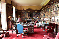 Inside the house on the Clandeboye estate, which is the home to Lady Dufferin, Marchioness of Dufferin and Ava. The library with bookcases inscribed in gilt with the names of Greek gods.
